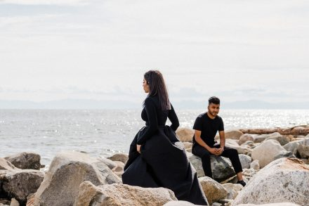 Edgy pre-wedding photo of a woman walking past a man