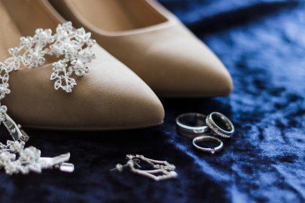 Wedding details - bride's heels, wedding rings, hair accessories