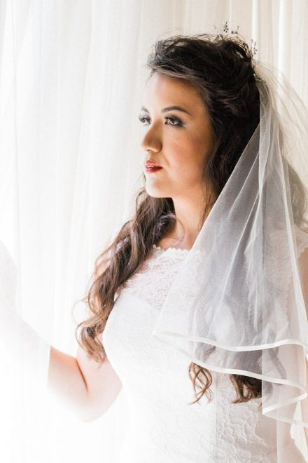 Beautiful bride looking into the window