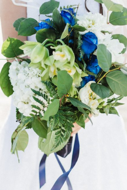 Marine-styled wedding bouquet with blue roses