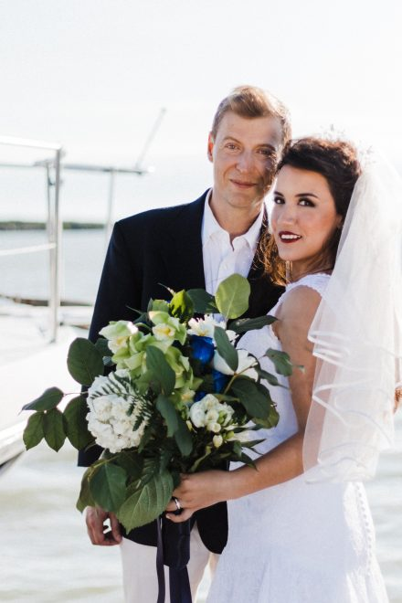 Portrait of a bride and groom with a yacht