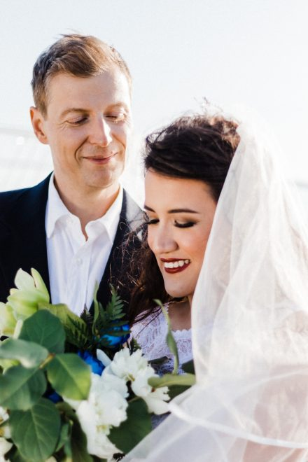 Portrait of a bride and groom laughing