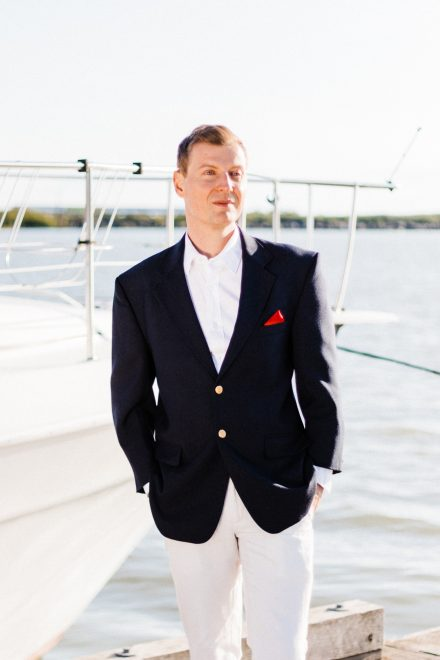 Groom dressed for nautical wedding