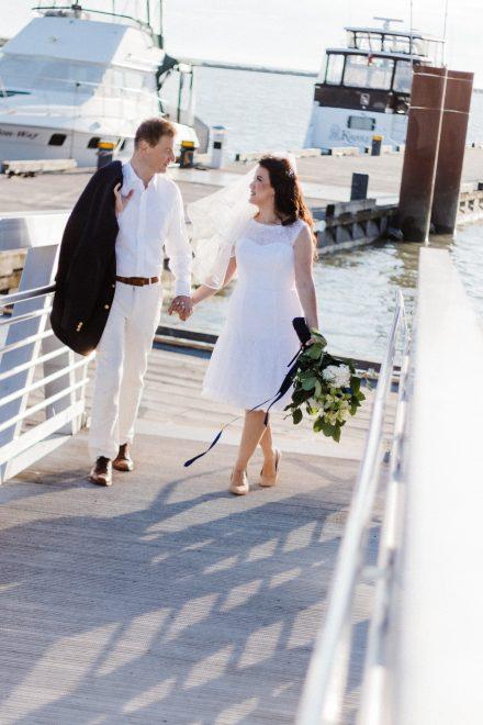 Nautical wedding, couple walking holding hands