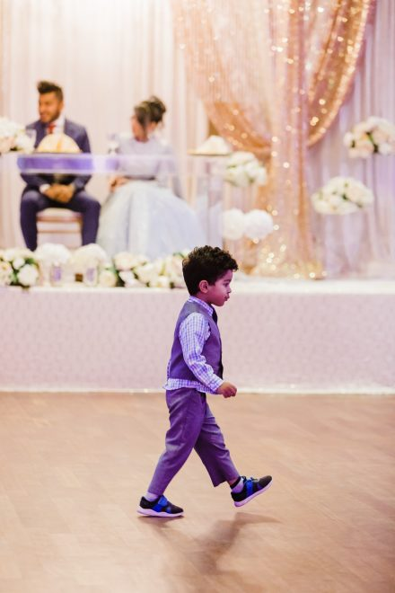 Wedding reception, toddler boy on a stage