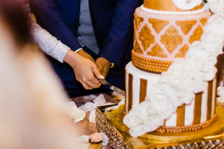 Wedding couple cuts wedding cake