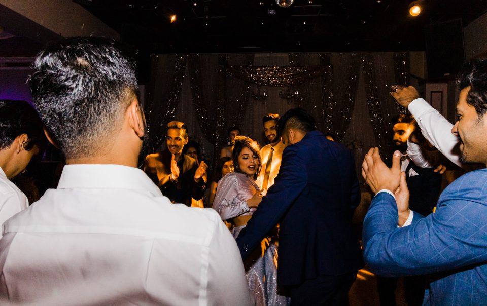 Wedding party, bride and groom dancing